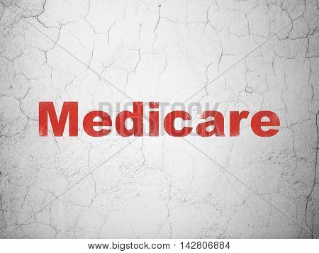 Health concept: Red Medicare on textured concrete wall background