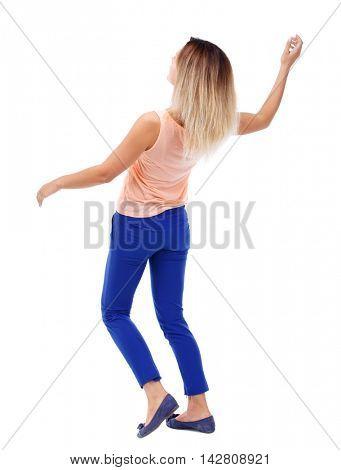 Balancing young woman.  or dodge falling woman. Rear view people collection.  backside view of person.  Isolated over white background. The blonde in a pink t-shirt dodges.