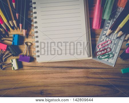Close up school and office supplies with notebook over office table. Top view with copy spacevintage-retro style