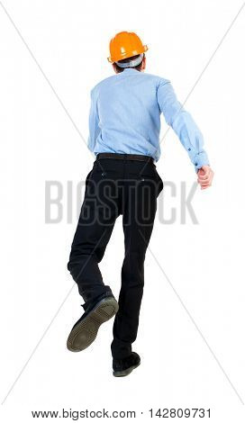 Back view of running engineer in helmet. Walking guy in motion. Rear view people collection. Backside view of person. Isolated over white background. Businessman in blue shirt and hat jumping on one