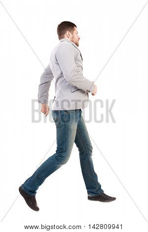 Back view of running business man. Walking guy in motion. Rear view people collection. Backside view of person. Isolated over white background. A man in a gray jacket moves with great leaps.
