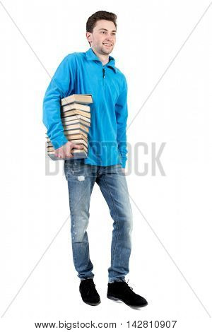 side view of going  man carries a stack of books. walking young guy . Rear view people collection.  backside view of person.  Isolated over white background.  The curly-haired student in a blue warm