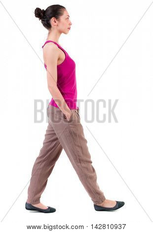 back view of walking  curly woman.  backside view of person.  Rear view people collection. Isolated over white background. dark girl passes by with his hands in his pockets.