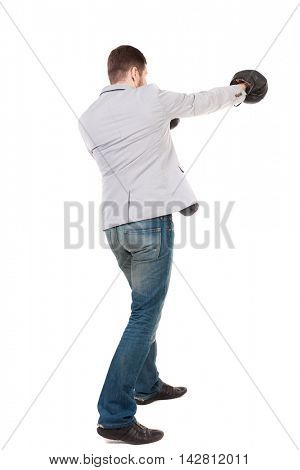 businessman with boxing gloves in fighting stance. Isolated over white background. Rear view people collection.  backside view of person. A guy in a gray jacket boxing gloves.