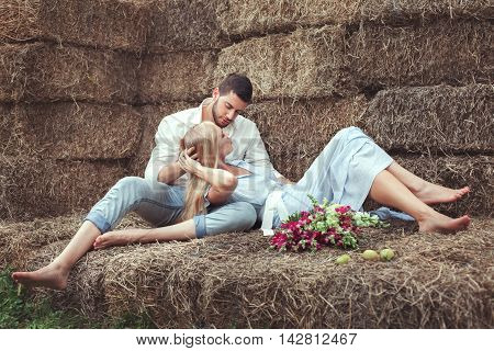 Man and woman in the hayloft they love and flirting.