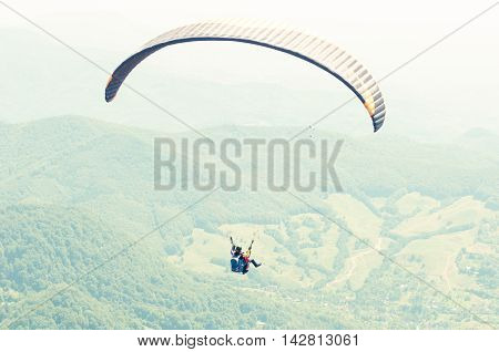 One Paraglider On Summer Day Over The Green Hills
