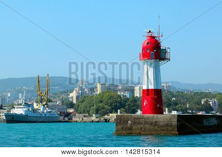 Closeup red lighthouse in the city of Sochi clear day