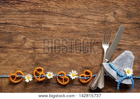Bavarian cutlery  on rustic wooden background with copy space for Oktoberfest