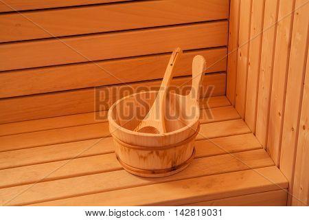 sauna accessories. wooden bucket with spoon. Interior