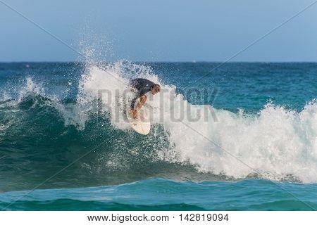 Sydney Australia - November 26 2014: A Australian surfer on the wave Bondi Beach in the Eastern Suburbs Sydney New South Wales Australia.