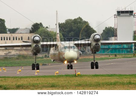 Kiev Ukraine - July 31 2012: Antonov An-32 Cargo Plane is preparing for a test flight after a maintenance and check
