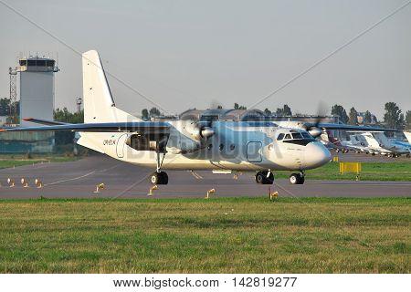 Kiev Ukraine - July 27 2012: Antonov An-24 turboprop passenger plane is taxiing to the runway before takeoff