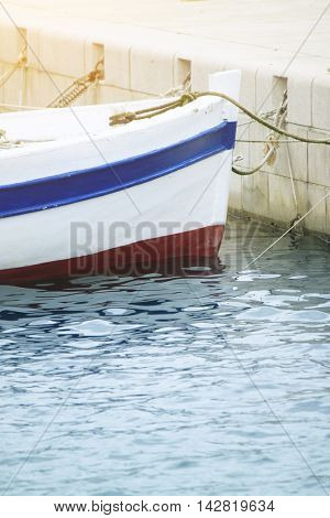 Detail of old wooden boat in a sea
