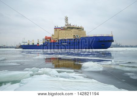 Icebreaker breaks the ice for the free passage of transport ships.