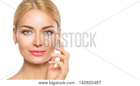 Beauty model woman face. Beautiful Spa Girl Touching her Face. Perfect Fresh Skin, makeup and manicure. Pure Beauty Female looking at camera. Youth and Skin Care Concept. Isolated on white background