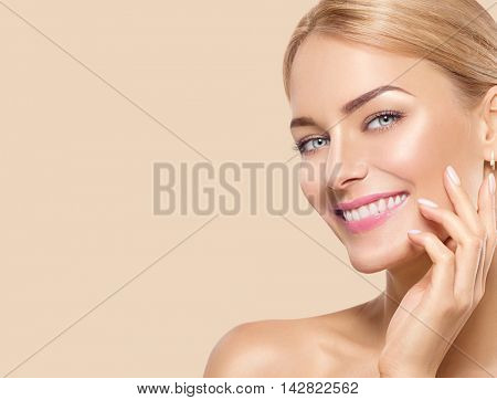 Beauty Woman Portrait. Beautiful Spa Girl Touching her Face and smiling. Perfect Fresh Skin. Pure Be