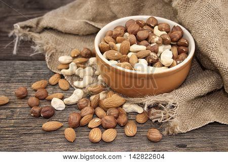 Almonds, Cashew And Hazelnuts On A Rustic Wooden Board. Healthy Concept. Soft Focus