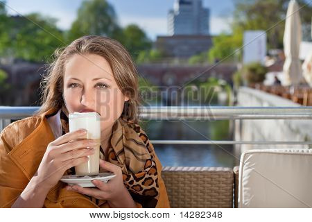 attractive young woman relaxing in cafe