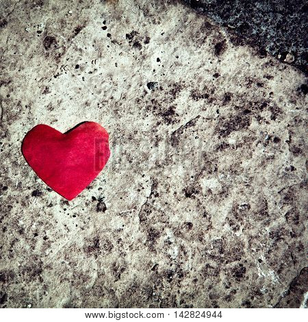 red papper heart on stone background, love concept