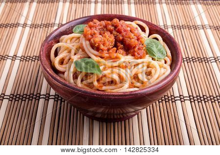 Italian Spaghetti With Tomato Relish And Basil Leaves