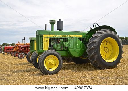 ROSHOLT, SOUTH DAKOTA, August 21, 2015: A long row of tractors featuring the 720 restored John Deere at the annual Rosholt Area Threshing Bee held the third full weekend of August.
