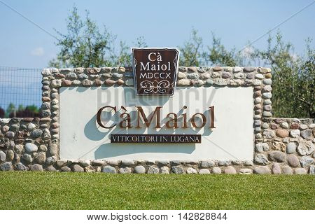 Desenzano del Garda Italy - May 07 2016: The advertising sign of production of wine Ca Maiol located in a North Italy