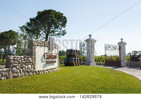 Desenzano del Garda Italy - May 07 2016: The gate to the factory for the production of wine Ca Maiol located in a North Italy