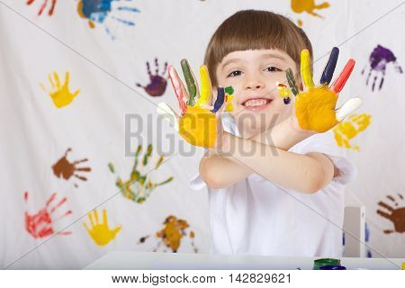 Boy Has Painted His Hands.