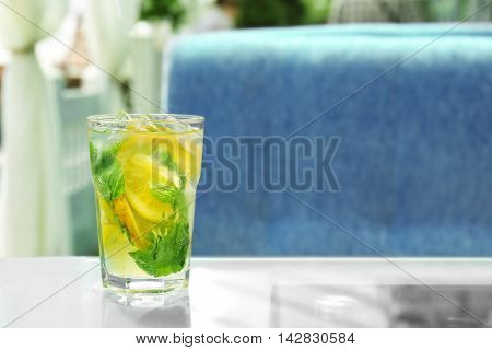 Glass of cool drink on table in cafe