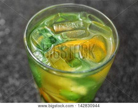 Glass of cool drink on table, closeup