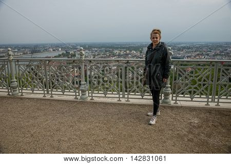 Budapest Hungary - April 10. 2016: Woman tourist poses at Citadel on Gellert hill in Budapest