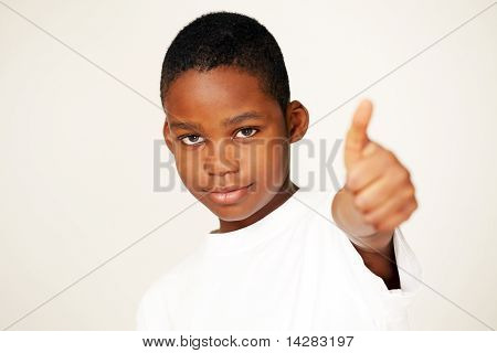 African boy thumbs up sign