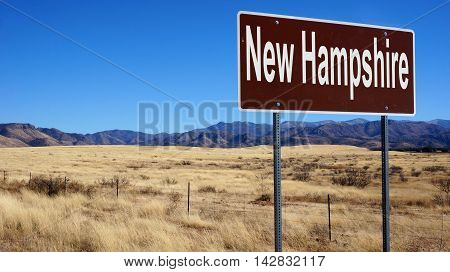 New Hampshire road sign with blue sky and wilderness