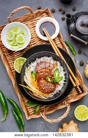Asian food - roast meat with rice and vegetables. View from above