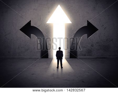 A businessman in doubt, having to choose between three different choices indicated by arrows pointing in opposite direction concept