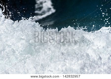Sea Foam Of The Waves Crushing Into The Shore Texture.