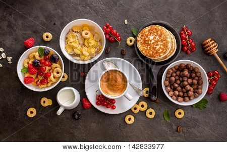 Breakfast cereals, pancakes, fresh berries and cup of coffee. Health and colorful Breakfast