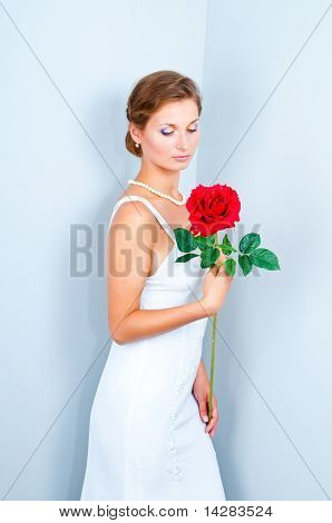 The bride with a red rose