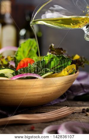 Fresh green salad with olive oil. Shallow depth of field