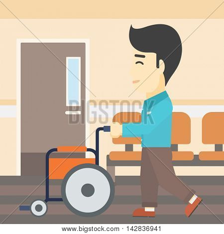 An asian young man pushing empty wheelchair on the background of hospital corridor. Vector flat design illustration. Square layout.
