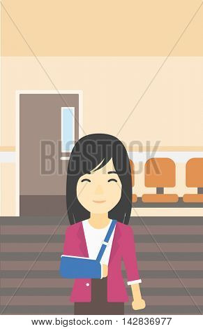 An injured asian woman with broken right arm in brace standing in the hospital corridor. Smiling woman wearing an arm brace. Vector flat design illustration. Vertical layout.