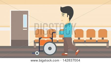 An asian young man pushing empty wheelchair on the background of hospital corridor. Vector flat design illustration. Horizontal layout.