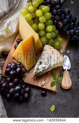 Various types of cheese and grapes, Food background. Selective focus