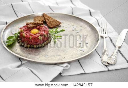 Tasty beef tartare on plate