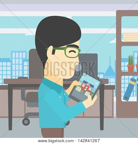 An asian man looking at house on a digital tablet screen. Young man standing in office and looking for house on tablet computer. Vector flat design illustration. Square layout.