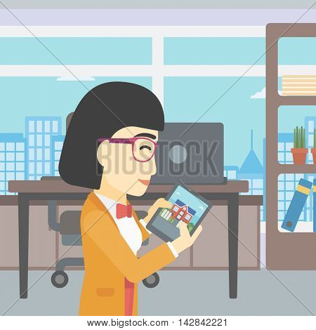 An asian woman looking at house on a digital tablet screen. Young woman standing in office and looking for house on tablet computer. Vector flat design illustration. Square layout.