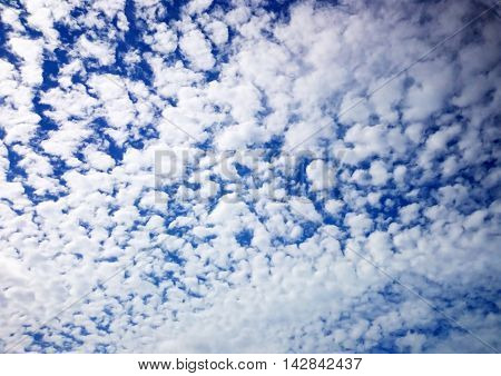 Scattered Cloud Formation In A Blue Sky