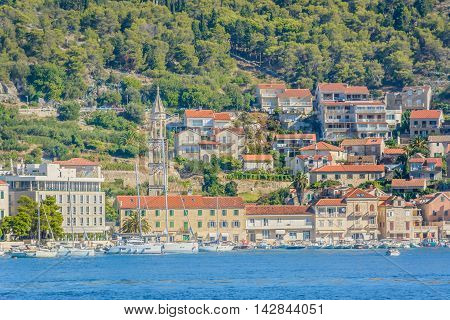 Waterfront view at famous touristic destination town Hvar, summertime in Croatia.