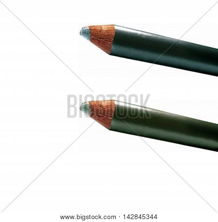 Part Of Metallic Cream Eyeshadow Pencils Green Isolated On White. Two-tone.