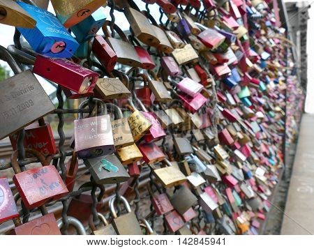 Cologne Germany September 12 2015: Thousands of love locks placed by lovers to the Hohenzollern Bridge Hohenzollernbrücke